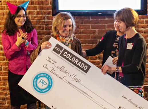Marni receiving her AIGA Pro Grant check at the AIGA Centenntial Birthday Bash last January.